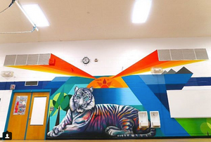 Denver street artists from the So-Gnar Creative Division painted this rad mural of a Tiger for Colfax Elementary.