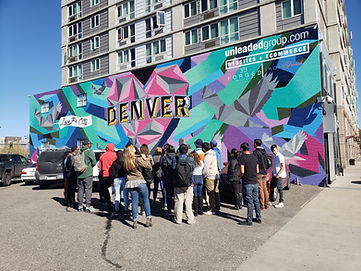 Mural/street art in Denver's RiNo Art District by street artist collective So-Gnar Creative Division.