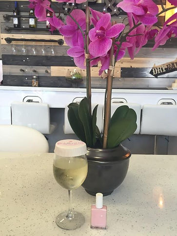 Decor and adult refreshments at Pink and White Nail and Spa
