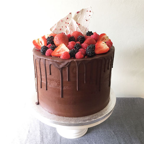 This whopper is a 10 inch round drip cake, with 4….jpg