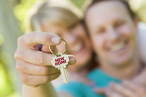 Happy Couple Holding House Key with New