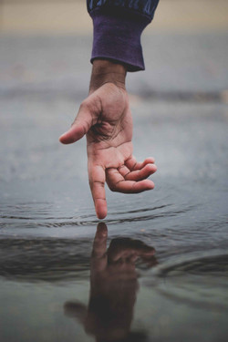 Crucial Pictures hand touching water