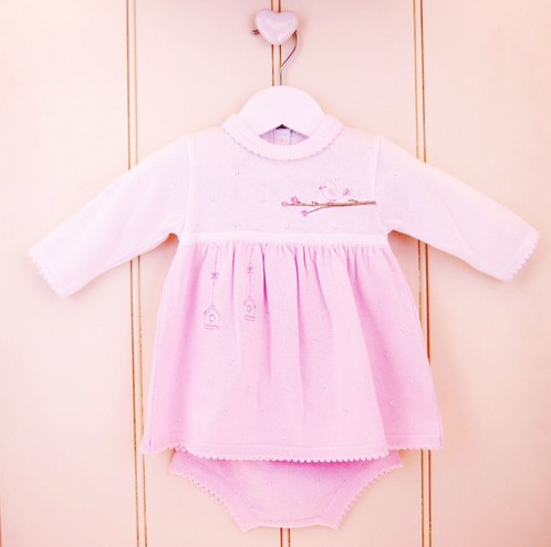 Baby girls embroidered dress in pink and white.