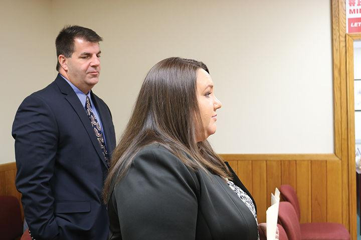 Greta Curry, deputy executive director of the Mingo County Redevelopment Authority, and Jon Webster, manager of External Affairs for Appalachian Power, address the Mingo County Commission seeking support of AEP's middle-mile broadband initiative.  Mingo Messenger photo by Terry L. May