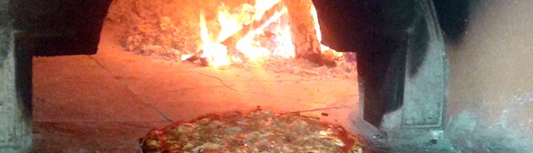 Wood oven with pizza