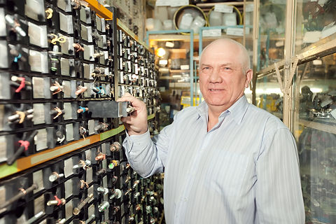 man-chooses-fasteners-auto-parts-store.j