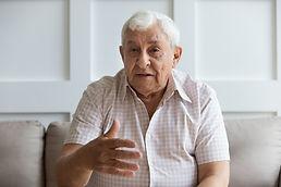 Head shot portrait serious older man loo