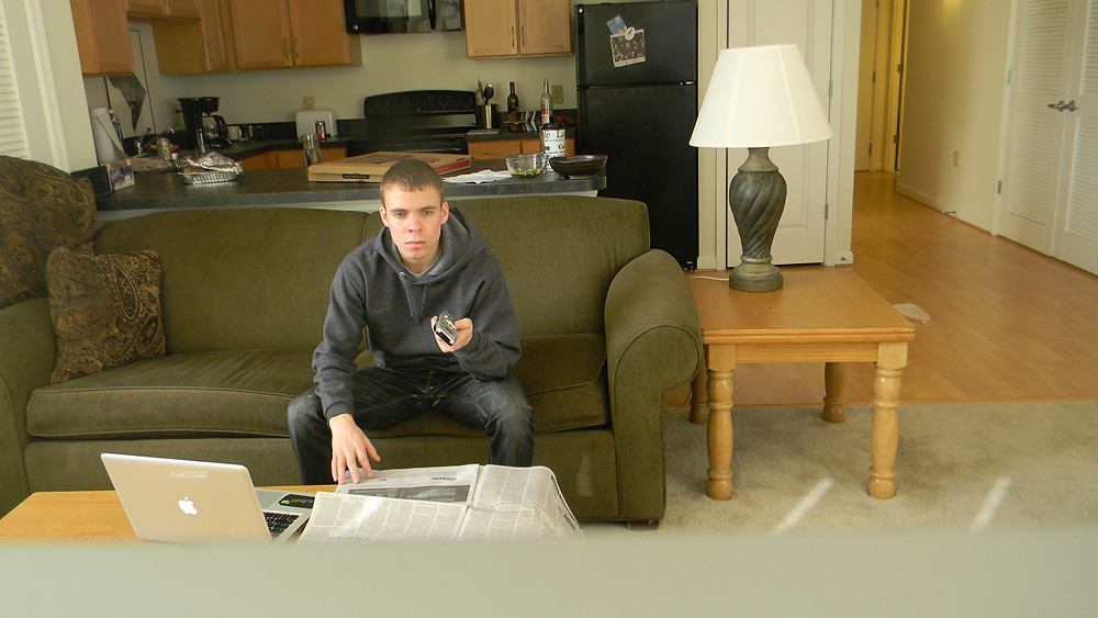 The author sitting in his Silver Spring, Md. apartment, watching television.