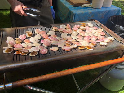 Swimming scallops on the BBQ during the BC Seafood Festival's Signature Weekend