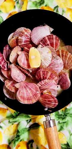 Sauted swimming scallops with butter, olive oil, shallots, garlic, and wine