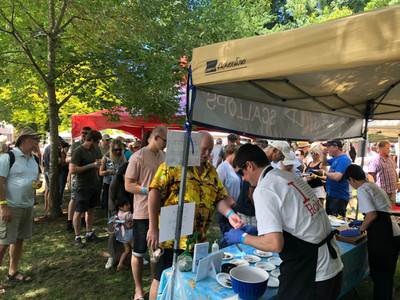 A long line of people waiting to try our delicious scallop dishes at the BC Seafood Festival's Signature Weekend, 2019