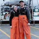 Melissa and Joel Collier standing in front of thier fishing boat, the Lisa Jess