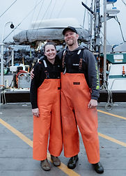 Melissa and Joel Collier in front of their fishing boat, the Lisa Jess