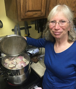 Marilyn Collier with a pot of steaming scallops