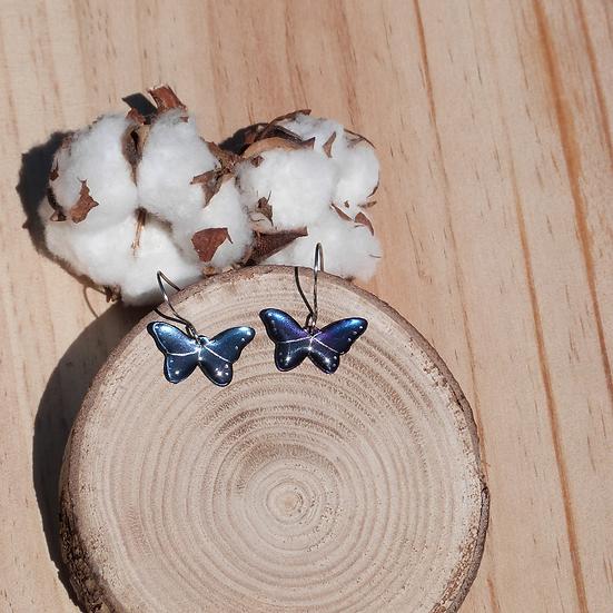 Boucles papillons bleus