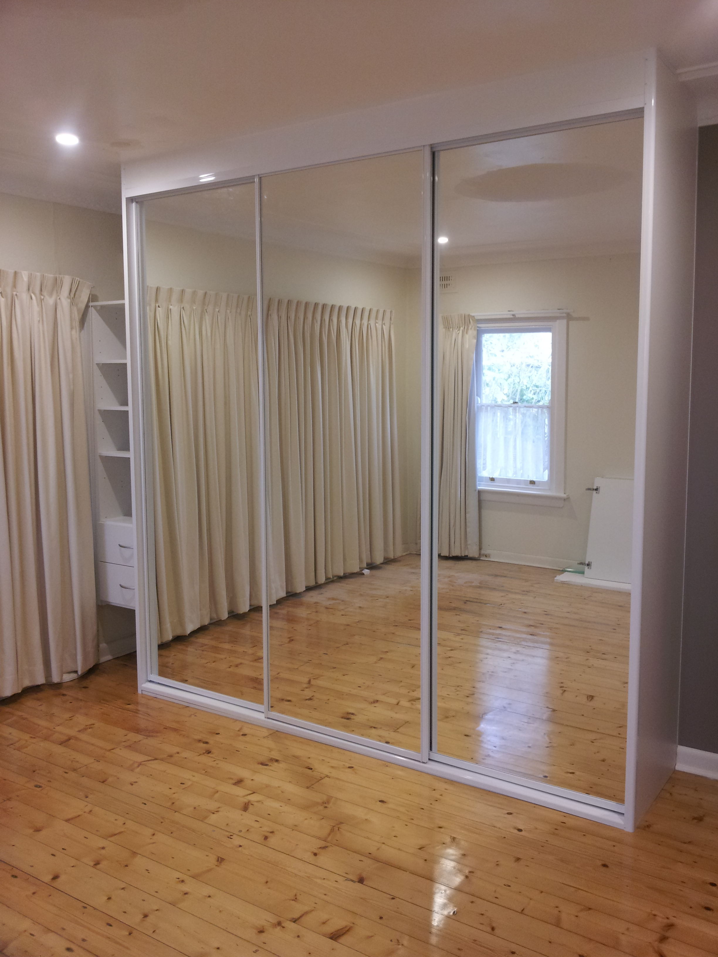 2 Framed Mirror Doors