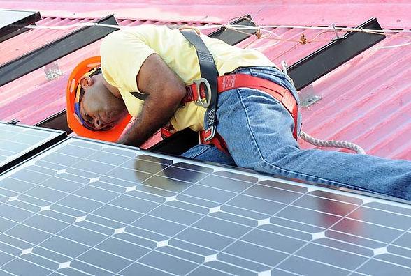 Solar panel engineer on roof installing PVC solar panels