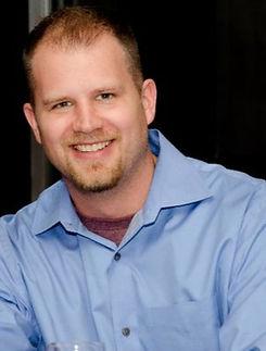 A man with light hair in a blue shirt, Jeff Neufeld