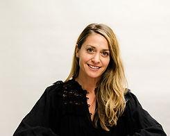 A woman with light hair in a black shirt, Anya Ashouri