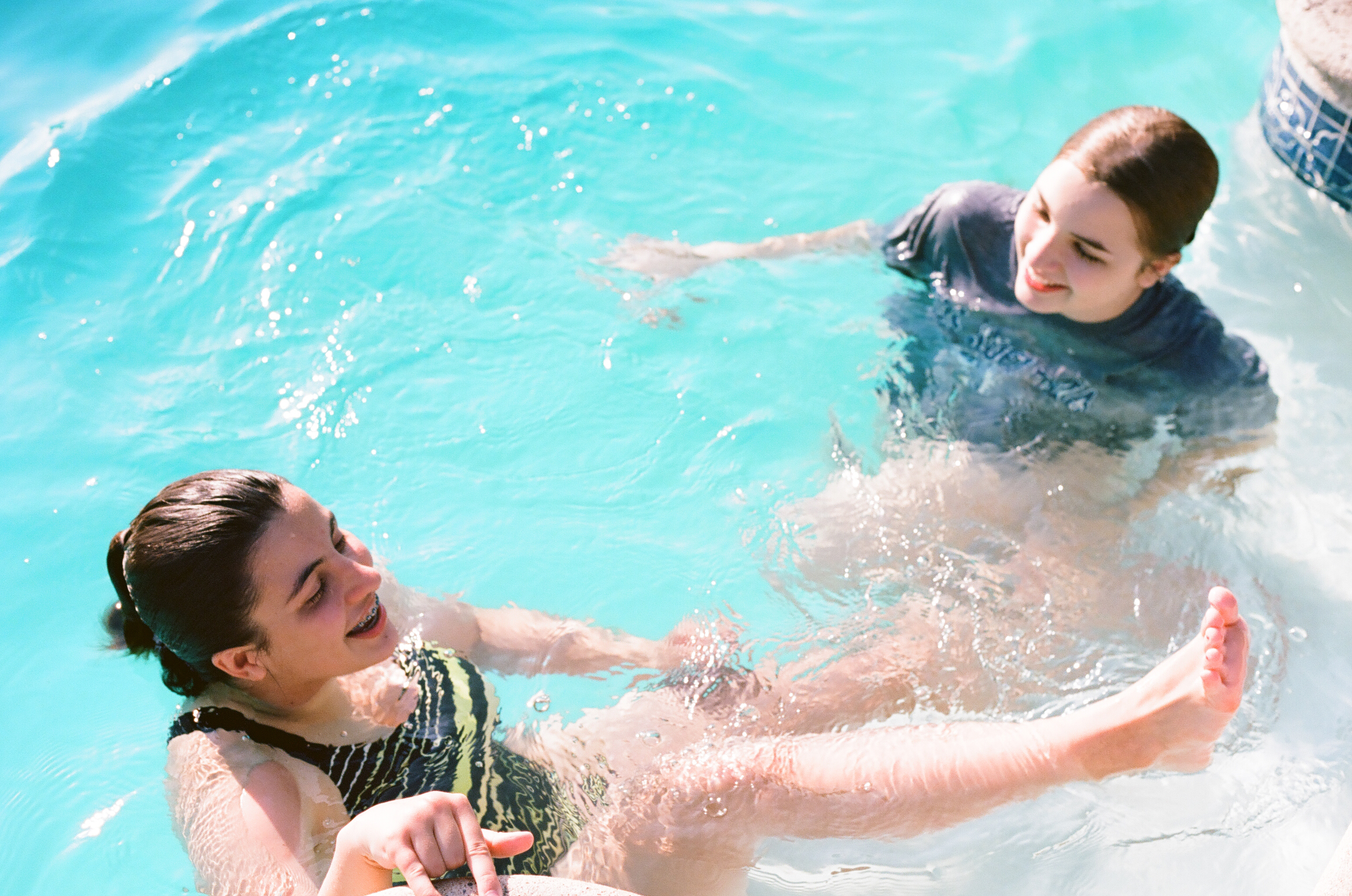 Teenagers swimming in pool