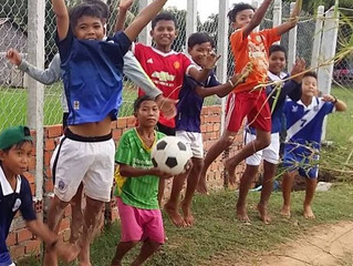 Children enjoying new playing field