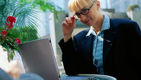 Blonde lady using laptop.jpg