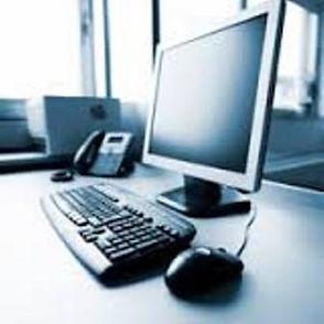 computer on desk weblrg.jpg