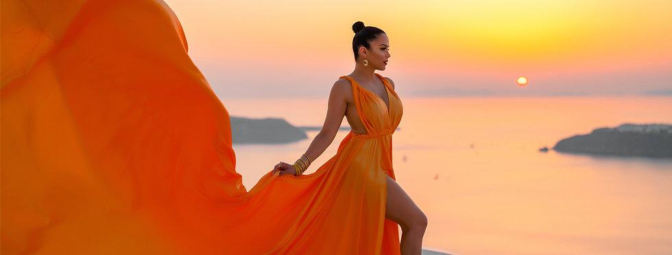 50. Orange satin transformer dress