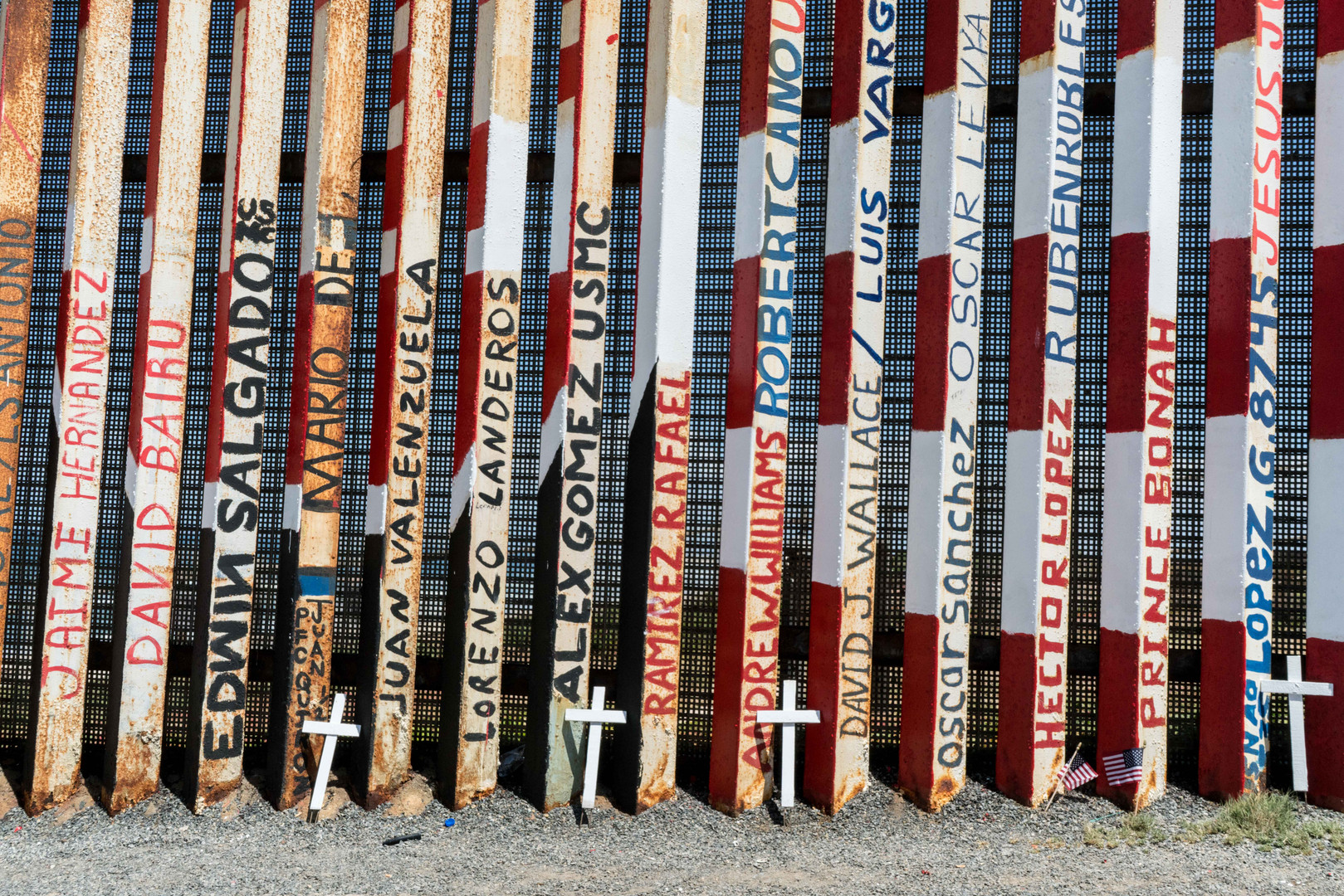 Names of deported veterans painted on the border wall