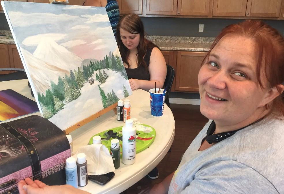Amber working on a painting