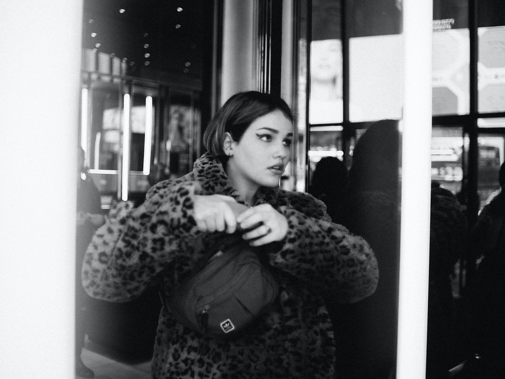 black and white photography, black and white girl, cheetah coat, girl in cheetah coat, girl in leopard coat, leopard coat outfit, bumbag outfit, bum bag, girl with makeup, cat eye makeup