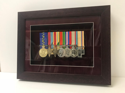 Framed cabnet-style so medals can be removed on ANZAC day.