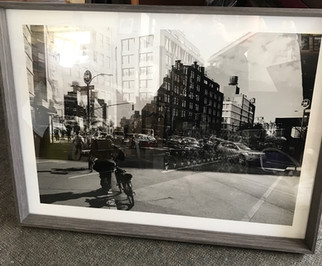 Award-winning photographs framed to enhance.