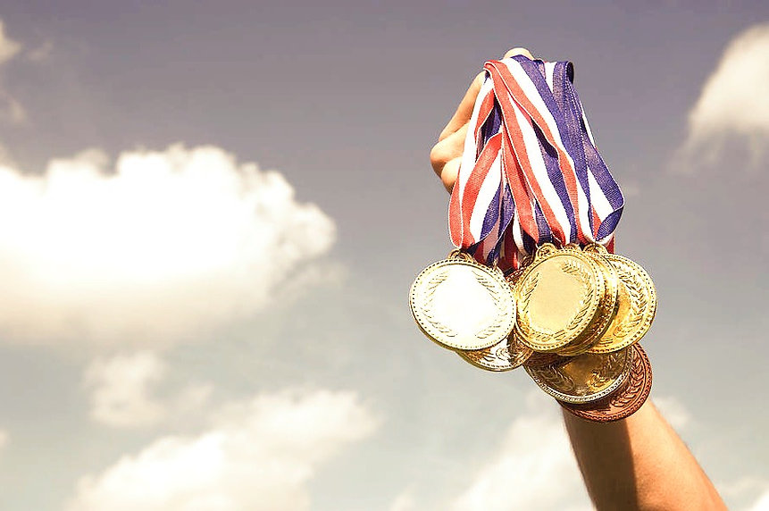 gold-silver-bronze-medals-hand-holding-u