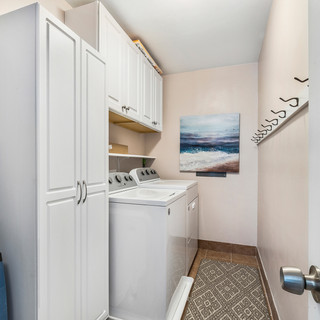 Laundry room with storage and place to hang towels.