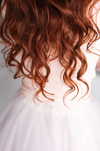 _long red hair on pink clothes.jpg