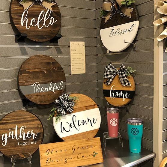 Wooden signs and tumblers