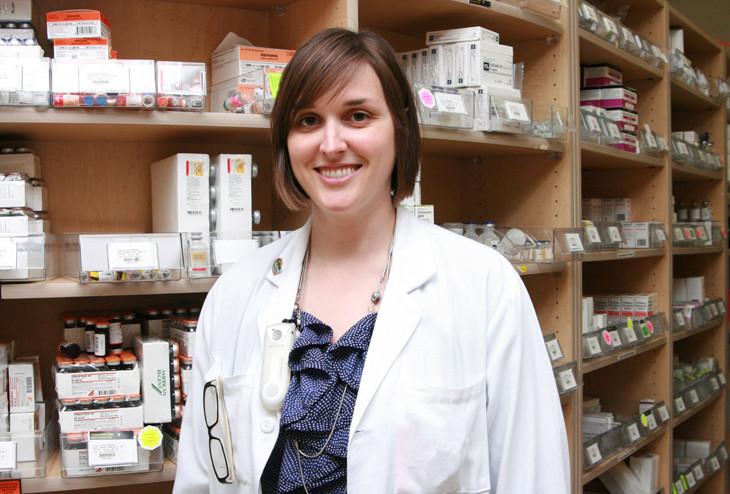 pharmacist with shelf stock