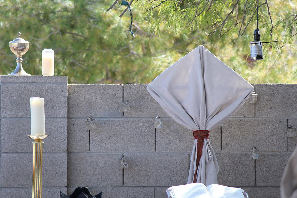 Procession cross veiled in Lenten array - unbleached linen and oxblood fabric