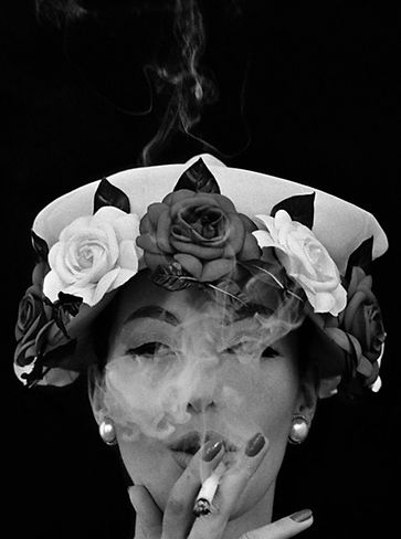 Photo by Willam Kein, Hat and five Roses, Paris, for Vogue, 1956