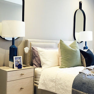 Guest bedroom with cushions and decorative furniture