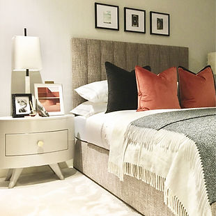 headboard, artwork, bedside table, lamp, burnt orange