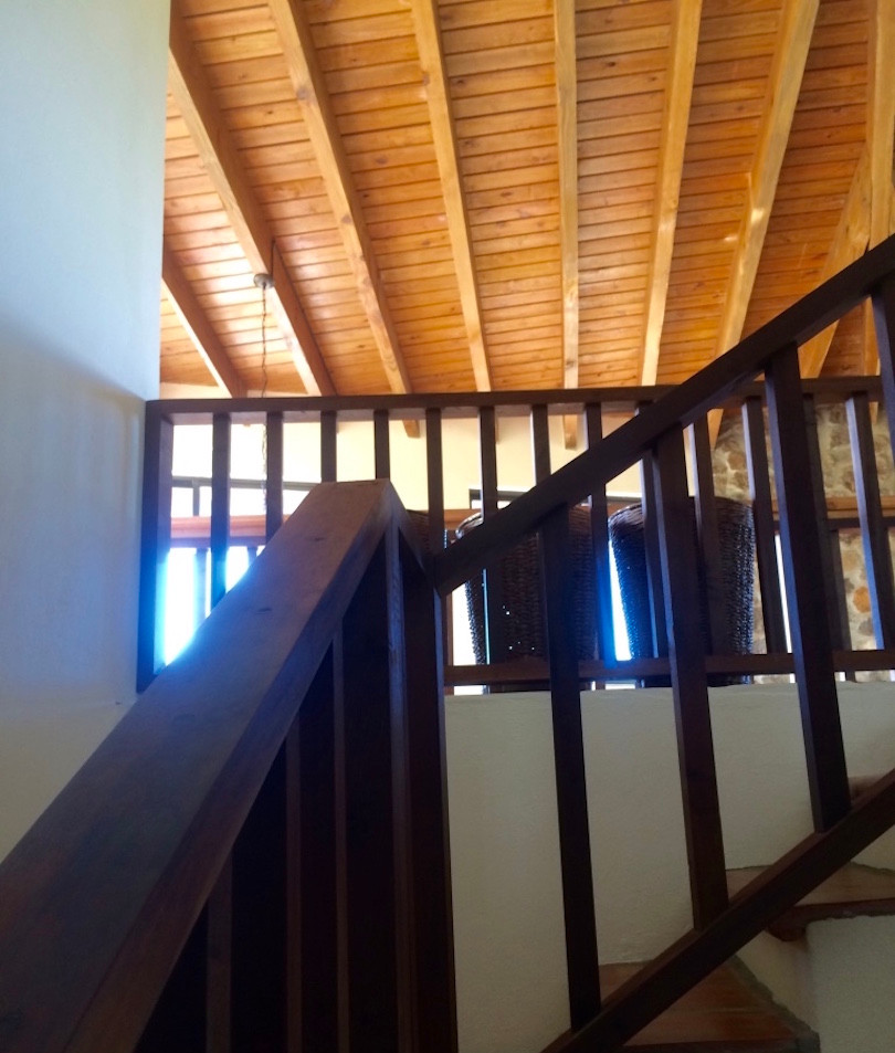 Stair to basement with washer/dryer/storage