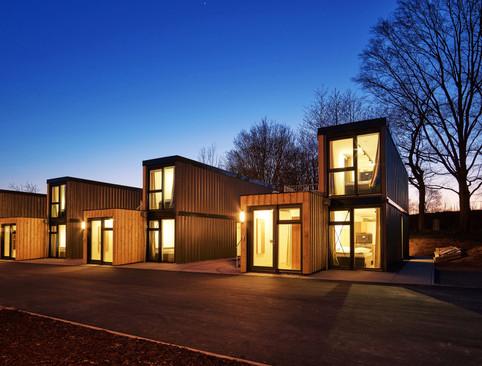 tiny-house-village-boardinghouse-sunset-
