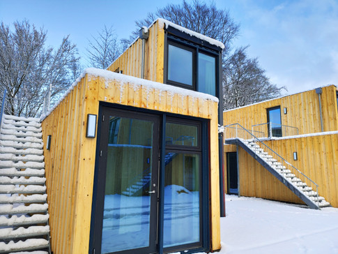 tiny-house-at-snow-warm-cozy-container-m