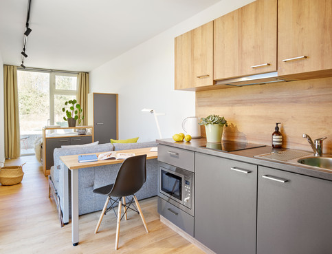 tiny-house-kitchen-table-working-area.jp