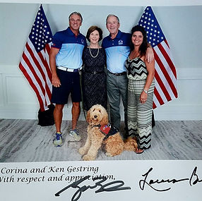 Meli and Family with President Bush.jpg