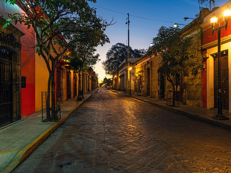 Street of Oaxaca city at sunrise with it