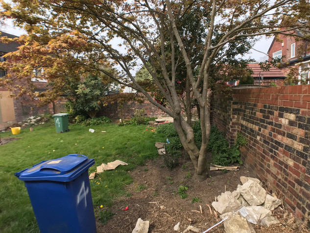 Across end of rear garden before