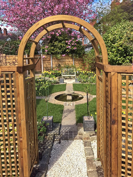 A central arbour surrounded by trellis p